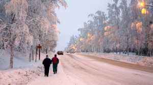 People walking up the unsusually colored snow road